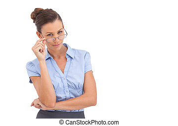Smiling businesswoman adjusting her glasses on a white...