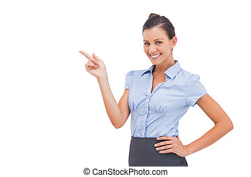 Cheerful businesswoman indicating something on the left
