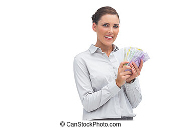 Businesswoman showing lots of money