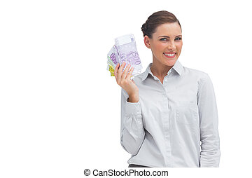 Happy businesswoman showing lots of money