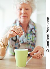 Old Lady Holding a Tea Bag - Old lady sitt