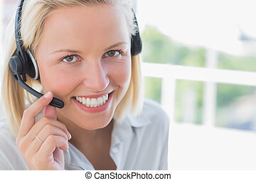 Businesswoman with headset smiling