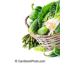 Fresh green vegetables in wicker basket