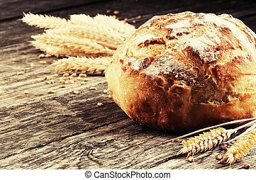 Fresh traditional bread on wooden table