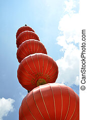 Red lanterns against blue sky