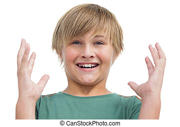 Suprised blonde boy with hands up on white background