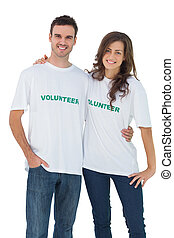 Two cheerful people wearing volunteer tshirt on white...