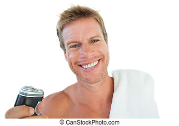 Cheerful man holding an electric razor