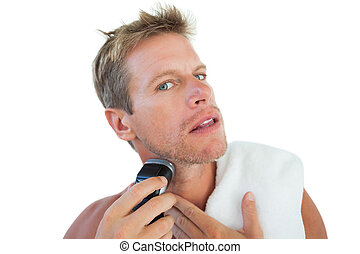 Shirtless man shaving his beard on white background