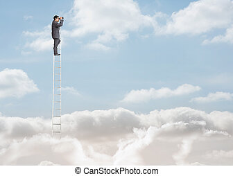 Businessman standing on a ladder over the clouds and looking...