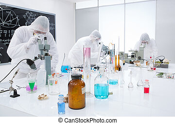 people analysing chemical reactions in a lab - general-view...