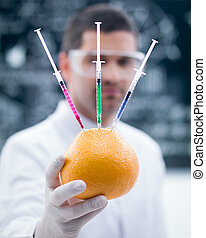 grapefruit chemical reseach - macro of a handheld injected...