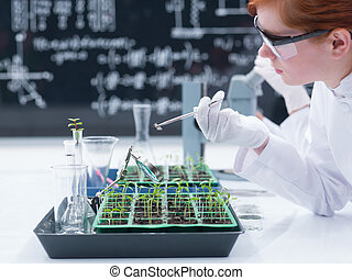 student analyzing in a chemistry lab - close-up of a student...