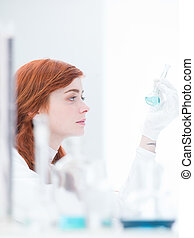 student lab experiment - side-view of a student in a...