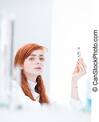 student lab pills analysis - close-up of a woman in a...