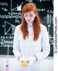 student scanning in chemistry lab - close-up of a girl...