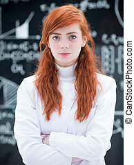 succesful student in chemistry lab - close-up of schoolgirl...