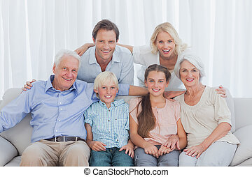 Extended family sitting together on couch