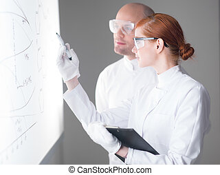 student analyzing graphics - side-view of a student pointing...