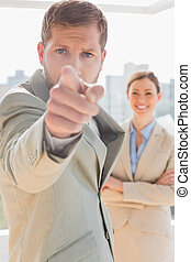 Annoyed businessman pointing at cam