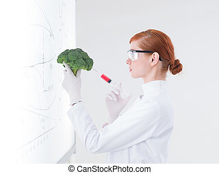 scientist injecting a broccoli - side-view of one beautiful...