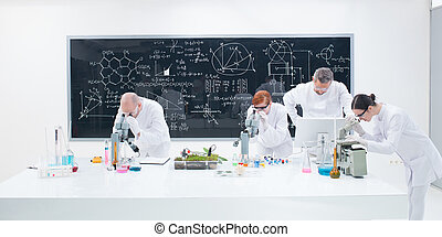under microscope lab analysis - close-up of researchers in...