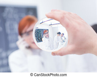 close-up of a beautiful student in a chemistry lab having...