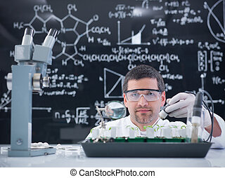 man lab plant experiment - close-up of a man in a chemistry...