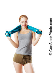 Woman in fitness dress with blue towel over her shoulder isolated on white