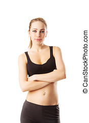 Woman in fitness dress with arms crossed isolated on white