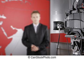 video camera and unrecognizable presenter - TV studio with...
