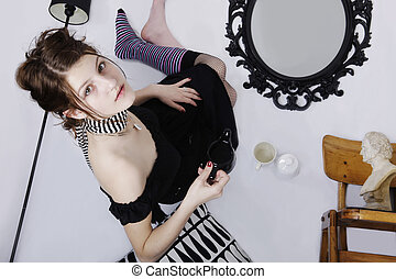 optical illusion of teen age girl on a ceiling - optical...