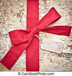 Wooden background with a red bow - Wooden background made of...