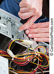 Work of computer specialist - Men repair computer with a...