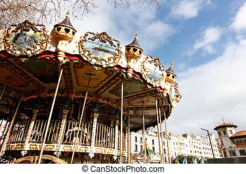 beautiful carousel with ancient drawings and decorations