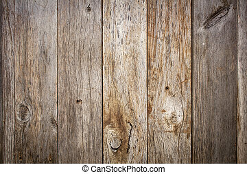 grunge weathered barn wood background with knots and nail...