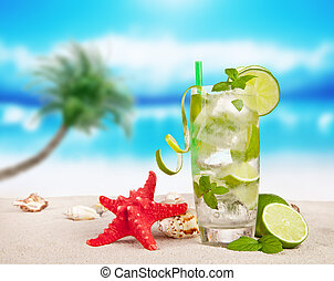 Summer drink - Mojito drink on beach with sea shells