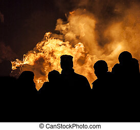 Bonfire Crowd - A gathering of people silhouetted against a...