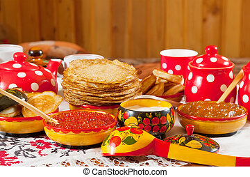 Russian Shrovetide table - pancake with caviar and tea