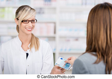 Patient pays for the medicine to the pharmacist