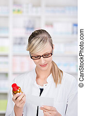 Female pharmacist reading the prescription