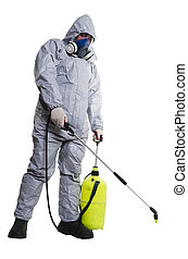PEST CONTROL WORKER - A pest control worker wearing a mask,...