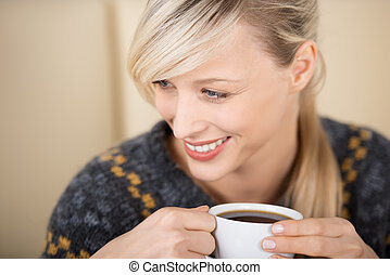 Attractive blond woman enjoying her cup of coffee