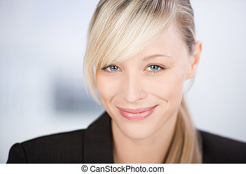 Smiling young businesswoman - Close up shot of smiling young...