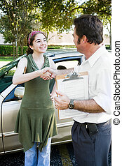 Driving Test Handshake - Teen girl getting a handshake from...
