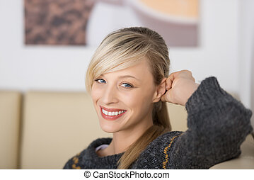 Seductive blond woman with a friendly smile