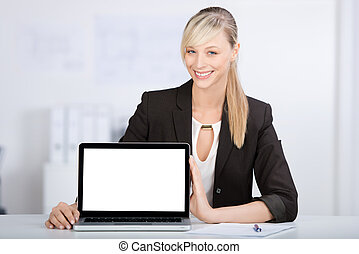 Laptop monitor - Young businesswoman showing a laptop over...