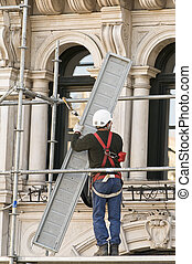 Worker - Workman putting up scaffolding