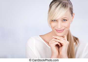 Smiling beautiful female over the white background