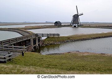 Mill along the Lancaster Deen on Texel.